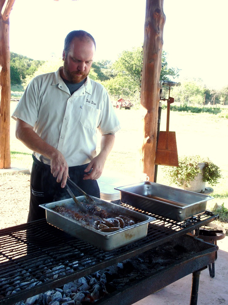 Jesse Griffiths at Montesino Farm in Wimberley grilling wild game.