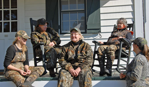 Women relaxing after the hunt. Image from National Shooting Sports.