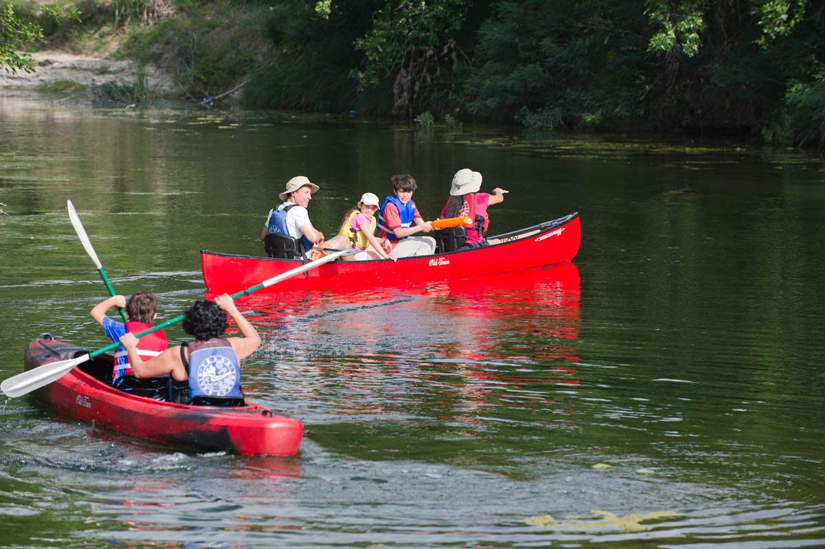 Family enjoying paddling on Texas paddling trail.