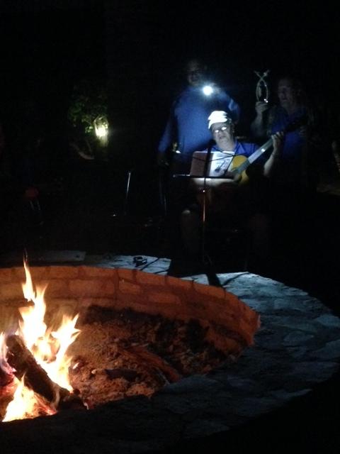 Singing around a campfire.