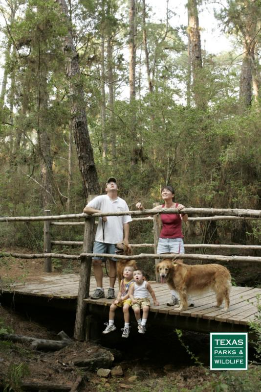 Family takes time to view wildlife while on a state park hike.