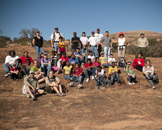 Families enjoying the outdoors together at Enchanted Rock State Natural Area.