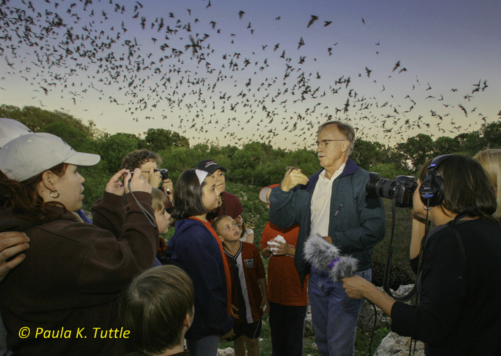 Merlin showing free-tailed bat to visitors at Bracken Cave during a National Public Radio interview. Media