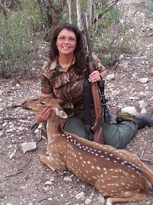 Sharon Cundiff, Straight N Arrow Archery, pictured here with her first deer. An Axis doe taken in Del Rio.