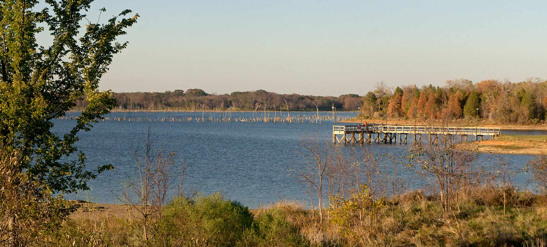 Long shot of fishing pier at Purtis Creek State Park in East Texas.