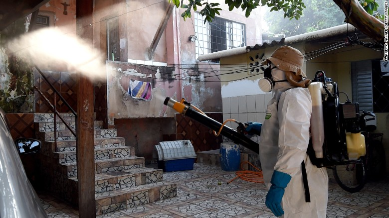 A health worker fumigates an area in Gama, Brazil, to combat the Aedes aegypti. Image courtesy www.cnn.com