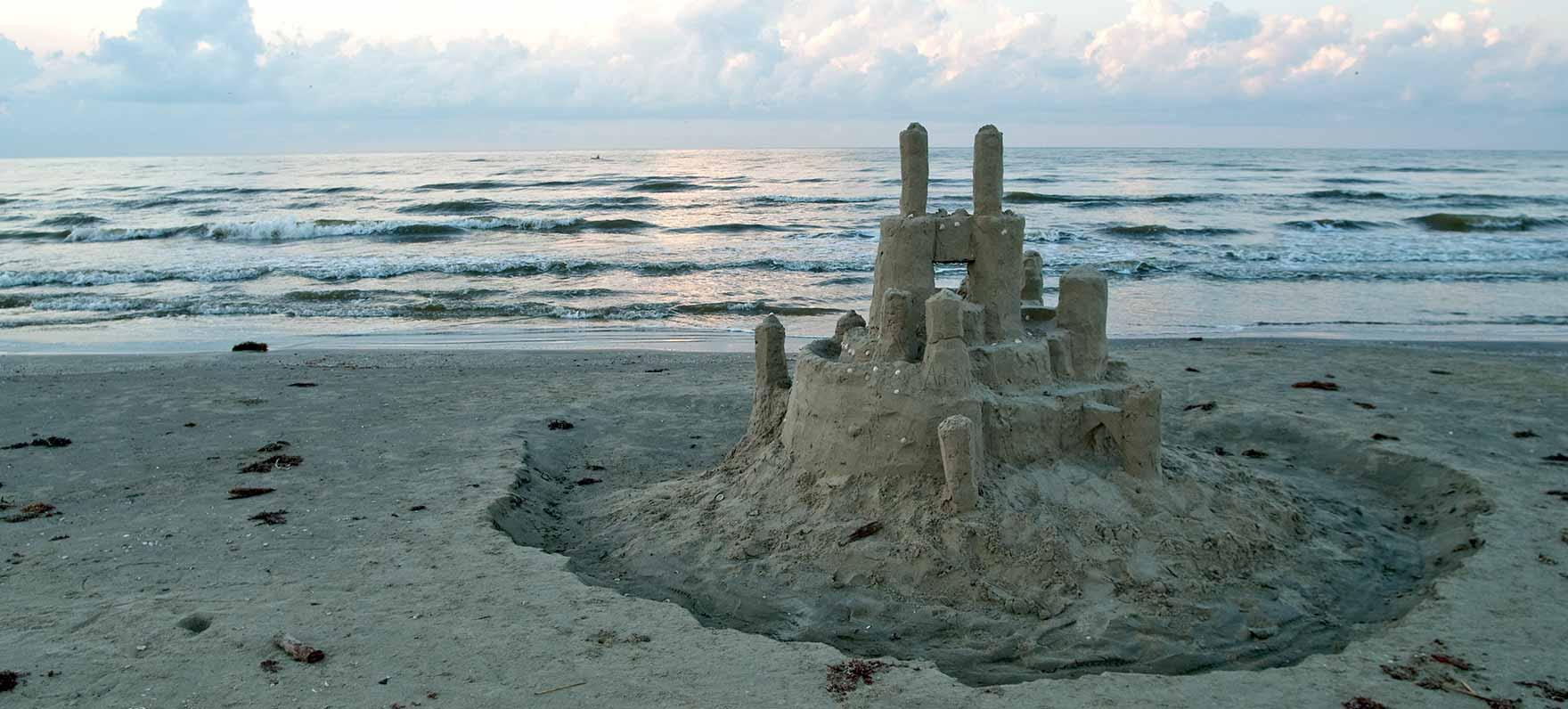 Sandcastle on beach at Galveston Island State Park.