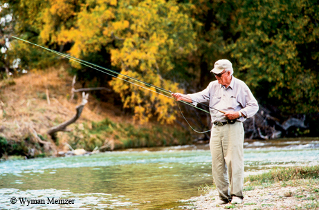John Graves checking fly rod on the Llano River.