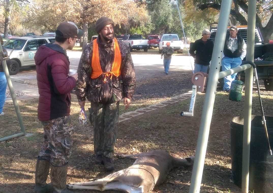 Ralston Dorn [left] and a fellow workshop attendee [right] discuss Dorn's success in the field. He shot his first deer (a doe) during a mentored deer hunt for adult novices, at inks Lake State Park.