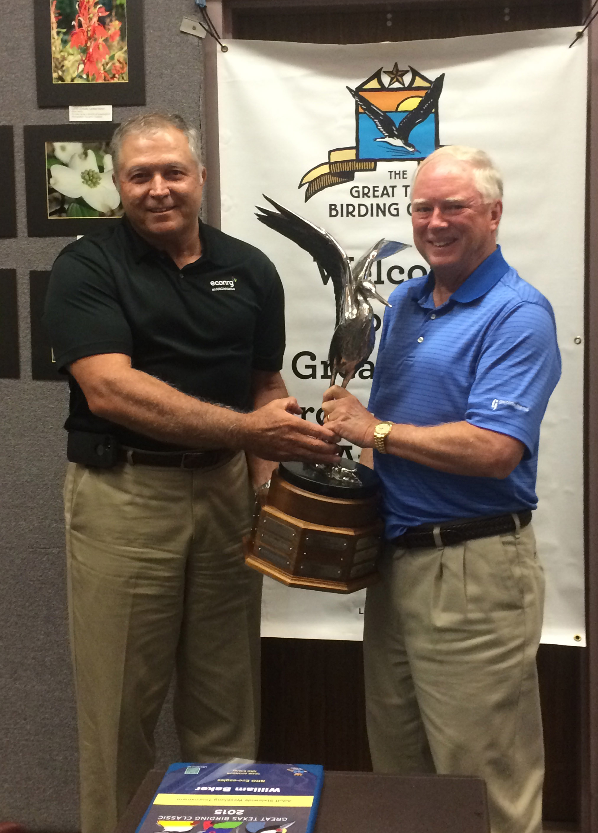 Bill Baker and Andy Dietrich, accepting the 2015 Statewide Weeklong Tournament winners trophy for the NRG Eco-eagles.