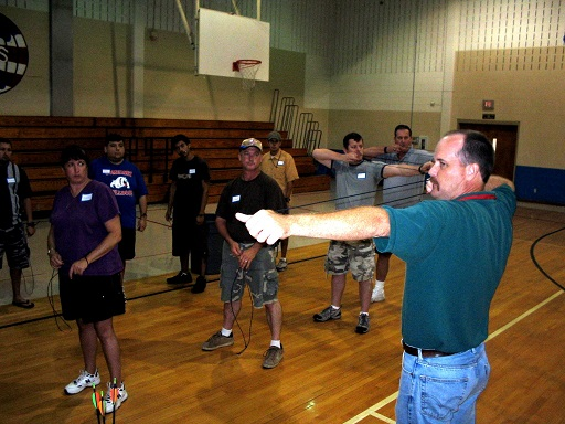 Burnie Kessner demonstrating how to use a bow.